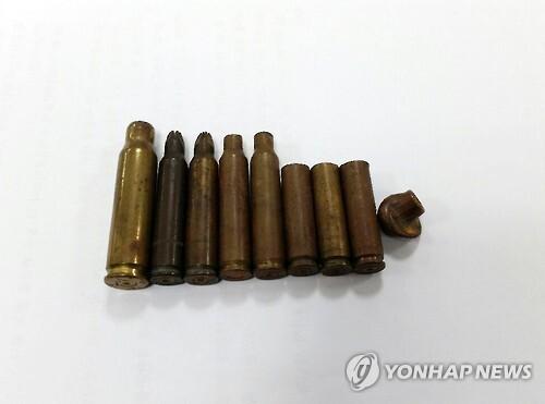 전일빌딩에서 발견된 5·18 당시 총알과 탄피 [5·18기념재단 제공=연합뉴스 자료사진]