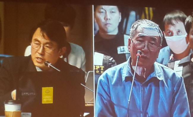 (사진 우측)이준석 세월호 선장이 김서중 청문회 위원에게 받은 질문에 대해 대답하고 있다.