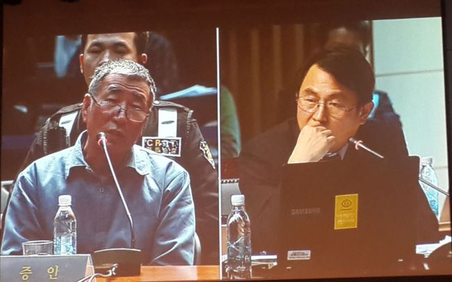 28일 서울시청에서 열린 제2차 세월호 청문회에서 이준석 세월호 선장이 김서중 청문위원의 질문에 답변하고 있다.