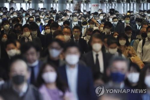 도쿄의 통근자들 [AP=연합뉴스 자료사진]