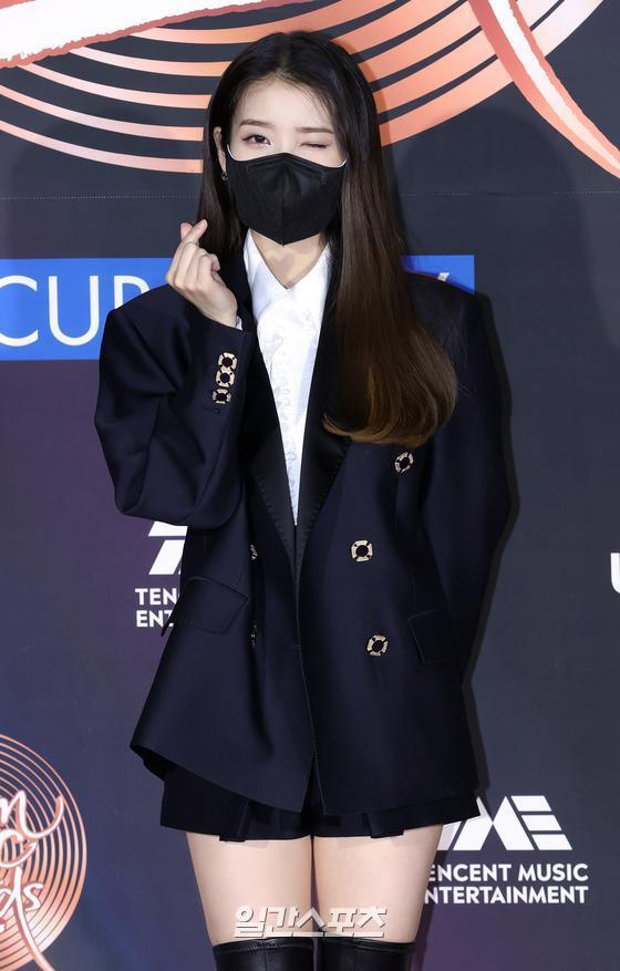 IU poses at the 35th 2021 Golden Disk Awards with Curaprox digital music photo wall event held at the KINTEX in Goyang, Goyang, Gyeonggi Province on the afternoon of 9th day.35th 2021 Golden Disk Awards with Curaprox will be broadcast on JTBC, JTBC2 and JTBC4.