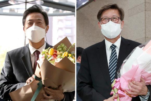 오세훈 서울시장(왼쪽)과 박형준 부산시장이 8일 오전 서울시청과 부산시청으로 각각 출근, 직원으로부터 받은 환영 꽃다발을 들고 있다. 연합뉴스