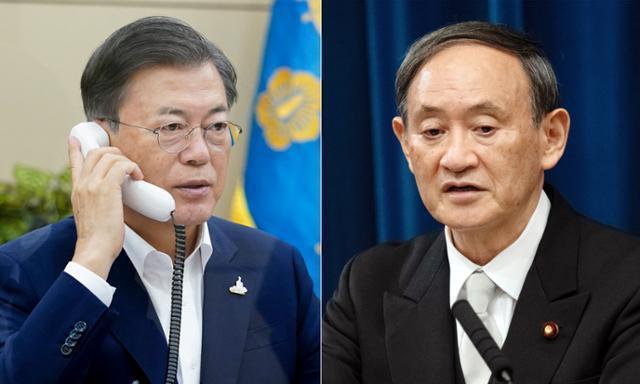 문재인 대통령이 지난해 9월 청와대에서 스가 요시히데(菅義偉) 일본 총리와 전화 회담을 하고 있다. 청와대 제공·EPA 연합뉴스